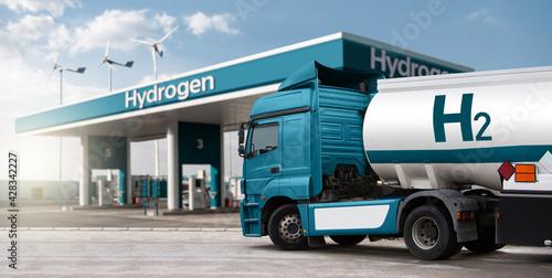 Slika na platnu Truck with hydrogen fuel tank trailer on a background of H2 filling station