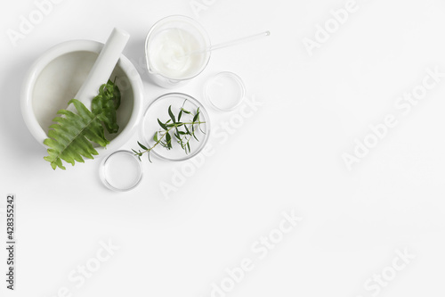 Obraz Organic cosmetic product, natural ingredients and laboratory glassware on white background, flat lay. Space for text - fototapety do salonu
