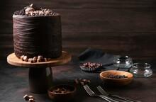 Delicious Freshly Made Chocolate Cake On Dark Background
