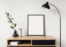 Blank Picture Frame Mockup On White Wall. White Living Room Design. View Of Modern Scandinavian Style Interior With Artwork Mock Up On Wall. Home Staging And Minimalism Concept