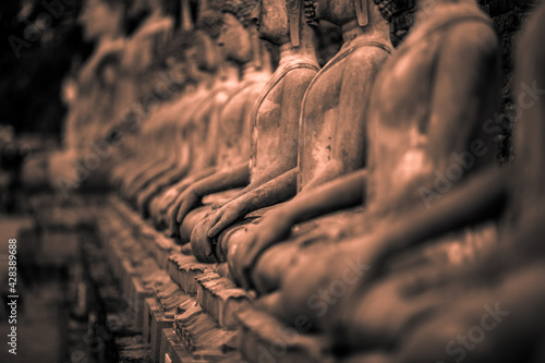 Canvas Print Background of old Buddha statues in Thai religious attractions in Ayutthaya Province, allowing tourists to study their history and take public photos