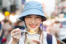 Closeup Young Adult Asian Foodie Woman Backpack Traveller Eating Asia Dessert Street Food.