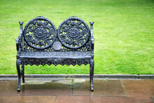 Decorative Wrought Iron Bench With Lush Green Lawn