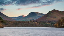 Stunning Long Exposure Landscape Image Of Derwent Water In Lake District During Autumn Fall Sunrise With Soft Pastel Colors