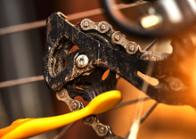 Cleaning The Rear Sprocket By A Toothbrush At On The Derailleur Of A Sporty Bicycle With Gears