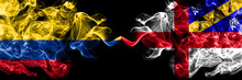 Colombia, Colombian Vs United Kingdom, Great Britain, British, Herm  Smoky Mystic Flags Placed Side By Side. Thick Colored Silky Abstract Smokes Flags.