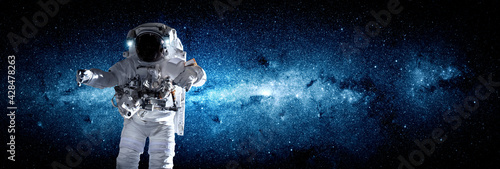 Astronaut spaceman do spacewalk while working for space station in outer space Wallpaper Mural