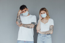 Faces Of People In Protective Masks From Coronavirus Hand Made. A Beautiful Quarantined Couple Protecting Themselves From A Pandemic. Positive Young Youth. Lifestyle COVID-19 Home Together