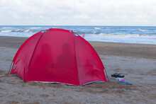 Beach Tent With Two People On A Sunny Day.