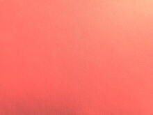 Abstract Red Background With Texture. Close-up Of Paper Surface With Light And Color Gradient. Side Lighting. Bright Crimson Backdrop