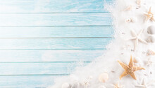 Summer Holiday, Travel And Vacation Concept. Beach Sand With Starfish And Seashell On Pastel Blue Wooden Background.