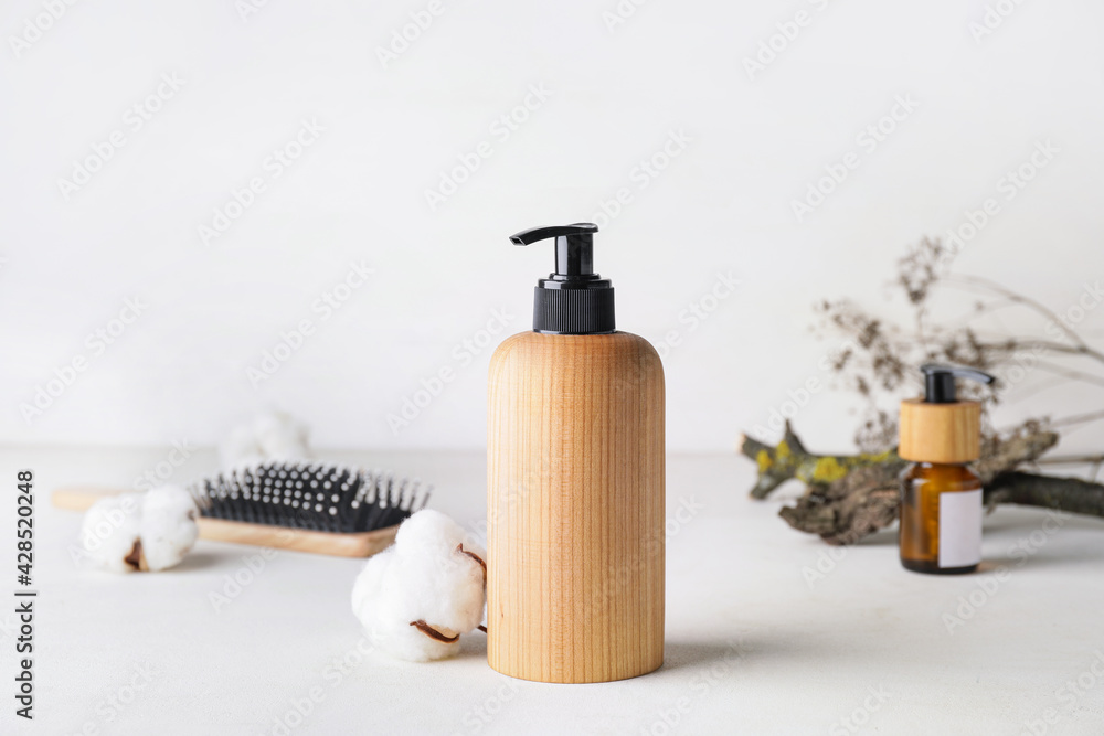 Bottle with natural shampoo on light background - obrazy, fototapety, plakaty