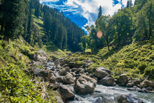 Landscape In The Mountains. The Beautiful River Flowing Between Alpine Meadows In The Lap Of Himalaya, Parvati Valley. Trek To Hamta Pass, 4270 M, Himachal Pradesh, India.