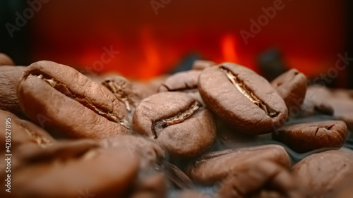 Fototapeta Close up of seeds of coffee. Fragrant coffee beans are roasted smoke comes from coffee beans. obraz