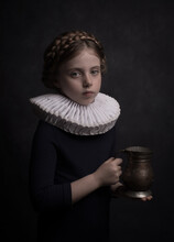 Classic Renaissance Portrait Of A Young Girl With A White Collar Holding An Antique Can