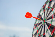 Red Dart Target With Arrows ,Image For Target Business, Marketing Solution Concept.of Dartboard With Sky Background.