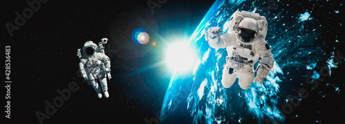 Canvas Print Astronaut spaceman do spacewalk while working for space station in outer space