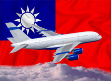 Taiwan Flag With White Airplane And Clouds. The Concept Of Tourist International Passenger Transportation.