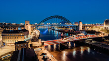 Newcastle Upon Tyne UK: 30th March 2021: Newcastle Gateshead Quayside At Night, With Of Tyne Bridge And City Skyline, Long Exposure During Blue Hour