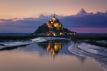 The Mont Saint Michel And Its Bay At The Sunset