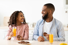 Cheerful African American Daughter And Dad Having Breakfast