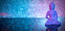 Illuminated Stone Buddha Statue On Acrylic Underground In Front Of An Illuminated Background