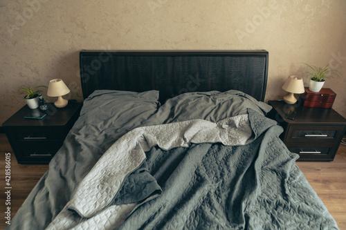 Obraz empty messy bed with grey sheets - fototapety do salonu