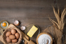 Bread Flour With Fresh Egg, Unsalted Butter And Accessories Bakery On Wood Background