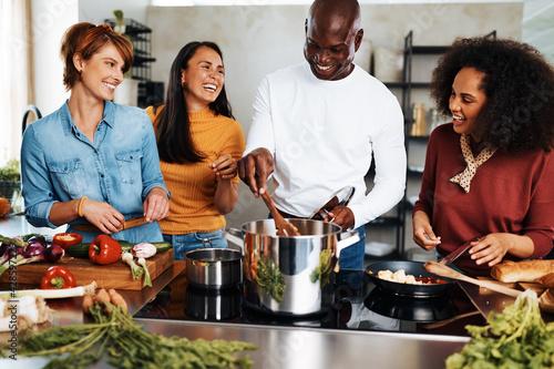 Fotografija Diverse friends cooking together