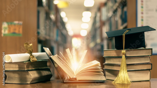 Online education, school study course, e-learning class, e-book digital technology and global educational success graduation concept with computer notebook open in library or classroom background - fototapety na wymiar