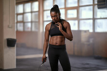 Woman Standing With A Skipping Rope At The Gym