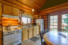 Modern Kitchen And Dining Room In Log Cabin Or Luxury House.
