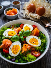 Salmon Salad - Smoked Salmon Hard Boiled Eggs And Green Vegetables On Wooden Table