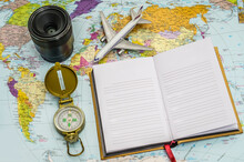 Travel Background Concept. Objective With Plane And Compass Put On Empty White Paper For Text. World Map On Background. Picture For Add Text Message. Backdrop For Design Art Work.