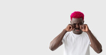 Crying Black Man. Depression Pain. Hysteric Feelings. Emotional Stress. Failure Regret. Upset African Guy With Bright Pink Hair Rubbing Eyes Wiping Tears Isolated White Copy Space.