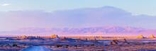 Pastel Sunset Over The Desert Valley