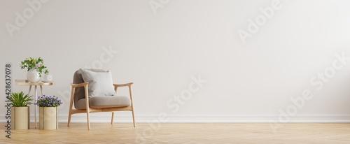 Obraz na plátně Modern minimalist interior with an armchair on empty white wall background