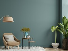 The Interior Has An Armchair On Empty Dark Green Wall Background.