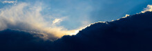 Dark Storm Clouds Illuminated By The Bright Evening Sun, Panorama
