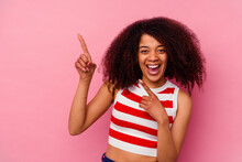 Young African American Woman Isolated On Pink Background Dancing And Having Fun.