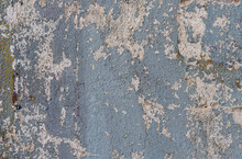 An Old Wall With Remnants Of Plaster And Cracked Paint From Time To Time In Different Colors As A Background Or Texture