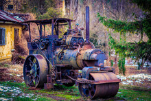 Old Decayed Rusty Agricultural Tractor Abandoned In Countryside