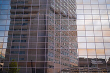 Building Reflected In Another Building