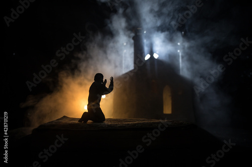 Fotografering Silhouette of mosque building on toned foggy background