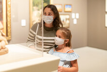 Mom And Daughter In Protective Masks Inspect The Exhibits Of The Museum