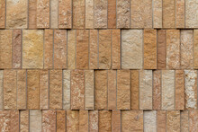 This Image Shows A Rough Texture Stone Wall Background With Attractive Narrow Vertical Kasota Limestone Blocks In Varying Widths, And Shades Of Brown And Beige
