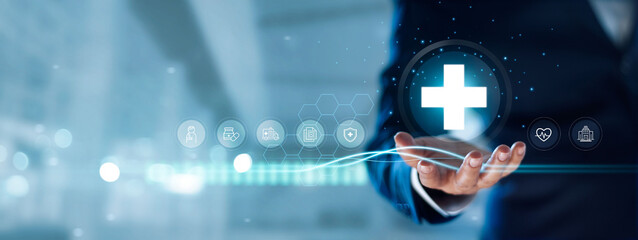 Businessman hold virtual medical network connection icons. Covid-19 pandemic develop people awareness and spread attention on their healthcare, rising growth in hospital and health insurance business.