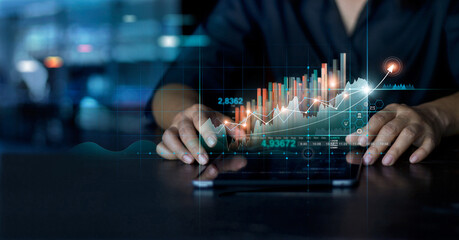 Businessman using tablet analyzing sales data and economic growth graph chart. Business planning and strategy. Analysing trading of exchange. Financial and banking. Technology digital marketing.