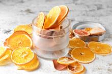 Jar With Dried Orange Slices On Light Background