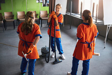 Janitorial Staff Taking A Break From Work